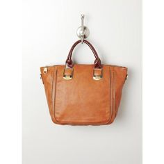 Steve Madden Bgambit Satchel W.Zipper Trim - Mine is a lighter tan with a creamy yellow block in the center, the handles are the same color as the pic! Happy Birthday to me! :)
