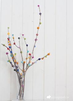 Must-Try DIY Pom Pom tree- spray branches black and glittery and then put orange and silver or something for Halloween