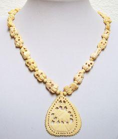 Vintage Carved Bone Bead Pendant Necklace by TastefullyCreative