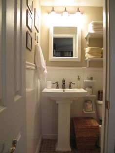 Bathroom. Small Beige White Bathroom With Pedestal Sink And Cool Space Saving Storage Ideas.