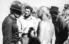 Rare behind the scenes still of Lee Marvin, Burt Lancaster, director/writer Richard Brooks and Woody Strode on the set of The Professionals (1966).