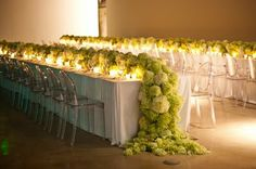 cascading green hydrangeas off a reception table, Ghost chairs