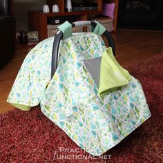 Make your own waterproof car seat canopy with this tutorial! It's soft, cozy, and will keep your baby warm in the cold winter months; great handmade DIY baby shower gift!