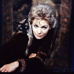 """This image of Kim Novak with a siamese cat appeared on the cover of LIFE magazine in November 1958. She was promoting the film ""Bell, Book and Candle."" (Ralph Crane—"
