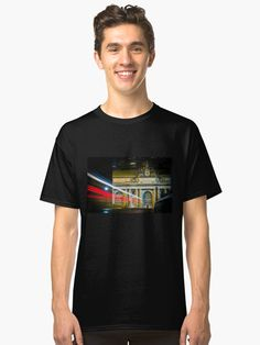 A car drives toward New York City's Grand Central Terminal at night, leaving a trail of red, white, and blue light. • Also buy this artwork on apparel, stickers, phone cases, and more. Men's Apparel, Trail, Light Blue, Classic T Shirts, Nyc, Phone Cases, Stickers, York, Night