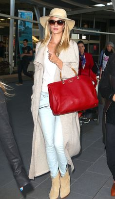 Rosie adds a pop of red with her Gucci bag
