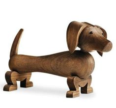 The Dog was born in 1934. Made of oiled walnut, this is an exact replica created from Kay Bojesen's original drawings. Beautifully packaged, this would make a wonderful gift for a newborn or Christening.
