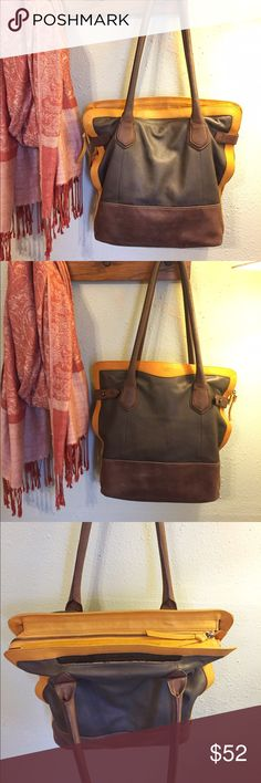"Perlina Leather Bag Beautiful soft leather shoulder bag. One main lined compartment and two smaller pockets with cell phone holding pocket. Normal wear. Few outer stains and light pen mark at top as photos show. Button side closures and zip top. Two tone brown color with orange. 14"" tall X 15"" wide across top. Handles to middle section at top measure 12"" tall. Width across bottom of bag is roughly 5"". Smoke free home. No trades. Thanks. Perlina Bags Shoulder Bags"
