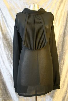 Sheer black pleated jabot blouse.