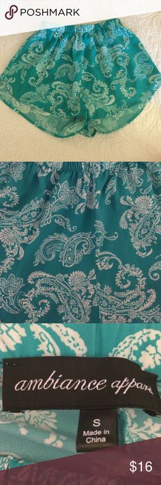 Paisley aqua shorts 100% polyester, aqua shorts. They are lightweight and you can dress them up or down. They have an elastic waistband to give a little stretch Ambiance Apparel Shorts