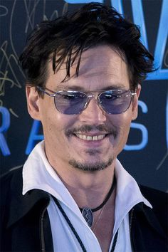 "Actor Johnny Depp attends a promotional event for his new movie ""Transcendence"" in Beijing, China, Monday, March 31, 2014."