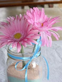 mason jars with silk flower and colored sand...