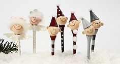 Christmas Decorations From Golf Tee's      Paint the golf tee with Plus Color Craft Paint – attach a poly head, wings, papier-mache cones and carded wool as hair using a glue gun.