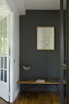 Beautiful Entryway. Love the contrast of the Gray wall against the white wall & white french doors. Love the Simple Bench & Artwork!  photo: Gilles Trillard for Cote Maison