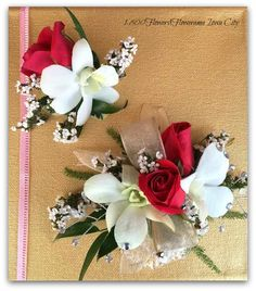 """Introducing """"Uptown Girl"""" from our Prom Show 2016 Collection featuring red sweetheart roses and white orchids with white heather accents. Hair clip and petite wrist corsage."""