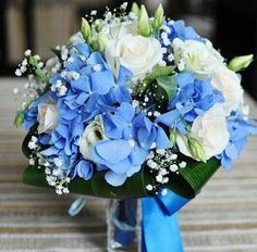 Wedding Bouquet Featuring: Blue Hydrangea, White Roses, White Lisianthus + Buds, White Gypsophila + Folded Green Aspidistra