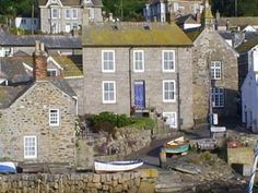 Mousehole, Cornwall England. Unbelievable narrow streets. We had to park outside and walk in. Crazy !