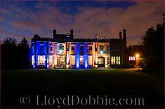 nonsuch mansion wedding venue lit up at night
