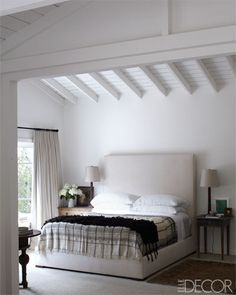 A custom-made bed by Jay Holman is dressed in Matteo linens.