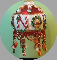 Noel 2014 - This is a detailed, step-by-step instructional pattern for an originally designed, beaded Christmas ornament cover in peyote