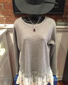 Loving this lace!! Grey sweatshirt with lace trim- $36.95 Grey floppy hat- $24.95 Purple stone necklace- $16.95  #madisonsbluebrick #fallfashion #lace #floppyhat #shoplocal #downtownhotsprings