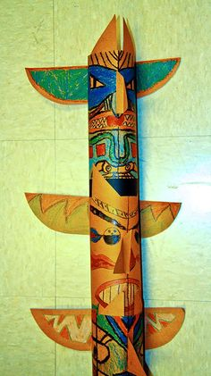 Totem poles made from craft paper, but could also make it out of an old paper towel roll.