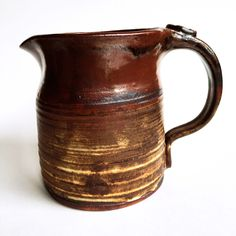 A personal favorite from my Etsy shop https://www.etsy.com/listing/462558477/studio-pottery-mini-pitcher-with