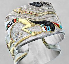Silver bracelet by Preston Monongye with inlay by Jesse Monogye, 2010. Made of coral, turquoise, acoma, jet, dolomite, gaspeite, diamond, ruby, 18K gold.