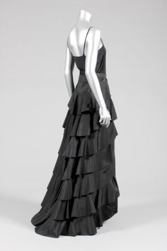 A Madeleine Vionnet tiered black silk skirt (originally a dress), 1936, printed orange on ivory satin label with thumb-print, the back and sides adorned with graduated tiers of taffeta, plain front | Kerry Taylor Auctions