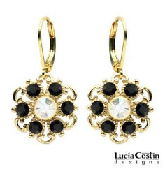 Lucia Costin Dangle Flower Earrings Made of 24K Yellow Gold Plated over .925 Sterling Silver with Twisted Line Accents, Black and White Swarovski Crystals; Handmade in USA Lucia Costin. $48.00. Produced delicately by hand, made in USA. Dangle earrings by Lucia Costin. Delicate floral design. Unique and feminine, perfect to wear for special occasions and evenings. Enhanced with black, white Swarovski crystals