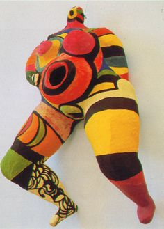 Niki de Saint Phalle (1930-2002) was a French sculptor, painter, and film maker. Inspired by of a friend, she began to use her artwork to consider archetypal female figures in relation to her thinking on the position of women in society. Her artistic expression of the proverbial everywoman were named 'Nanas'. The first of these freely posed forms—made of papier-mâché, yarn, and cloth—were exhibited at the Alexander Iolas Gallery in Paris in September 1965.