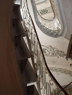 Grandiose spiral staircase and frescos, Malta.  I do love old Maltese architecture. It's a shame many buildings are allowed to fall into disrepair.