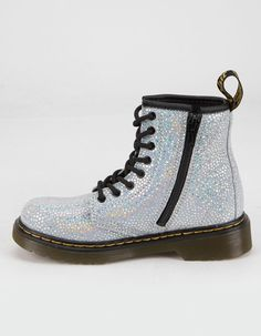 Dr. Martens 1460 Metallic Suede Lace Up Boots. These boots are built from soft, metallic-print suede that makes a scene at any occasion, and come loaded with classic Docs DNA. With a medial zip for easy on/off access, they're lined for optimum comfort. 8 eye work boot. Spot metallic suede upper. Flexible cemented sole. Heel loop. Yellow stitching. Bouncing soles. Imported. #docmartensoutfits Doc Martens Outfit, Live In Style, Metallic Prints, Lace Up Boots, Dr. Martens, Dna, Combat Boots, Stitching, Scene