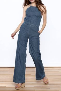 This sleeveless denim jumpsuit is a faux halter top with a band to cinch in the waist, and a wide pant leg.    Open Back Jumpsuit by LITZ. Clothing - Jumpsuits & Rompers - Jumpsuits Manhattan, New York City New York City