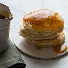 Light and fluffy Apple Cinnamon Pancakes are made extra special in this recipe when served with our brown sugar-buttermilk syrup.