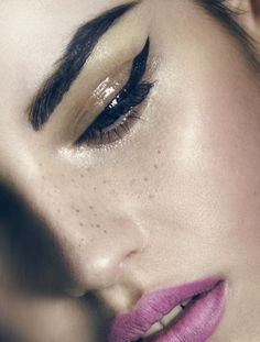 Perfect cat eye and stained lips.