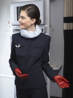 Air France cabin crew uniform -- love her red leather gloves!