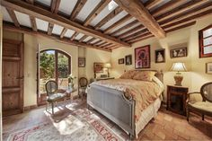 It looks like a cozy Italian villa, but this gorgeous bedroom is located in Laguna Beach, CA!
