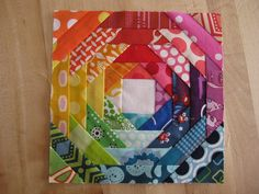 this is pretty, i like how it all blends into each other!  these would be fun potholders to use up the scraps!