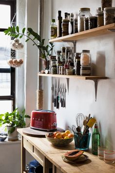 rustic kitchen with open shelves for spices and cooking must-haves