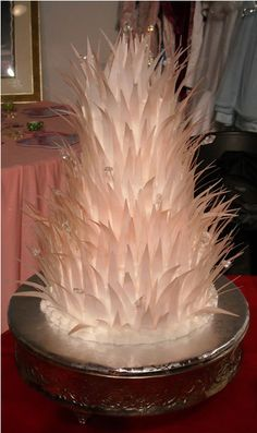 """Feather Cake - My attempt at a feather cake. Feathers are 1"""" strips of rice paper and dusted with rose luster dust. Glass beads were added to give it some sparkle."""