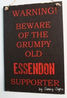 Grumpy Bombers Essendon  Footy Sign  Welcome to Saucy Signs...  Located in rural Australia, Saucy Signs is a creative small business featuring hundreds of original handcrafted wooden signs for you to choose from.  Each sign is created individually and features a shabby look with attention to detail. Our signs measure approximately 12 x 9 inches or 30 x 21 cms. Larger signs can be ordered as custom signs.  The shabby and rustic finish of our signs is intentional, as is the brushed, scratchy…