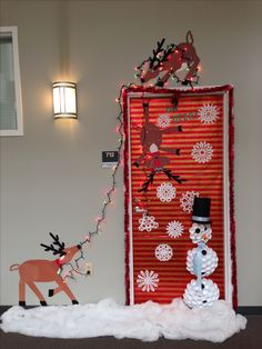 Our Christmas door decoration -- FIRST PLACE!! Made snowman with Dixie cups. Reindeer from construction paper. Snow from sewing fluff.