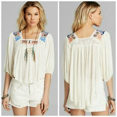 FreeBird Embroidered Alabaster Blouse White with high low hem and colorful embroidery. New with tags, no flaws, unworn. I don't want to sell this piece, but I really need the cash right now and this beauty has just been sitting in the back of my closet. Fits true to size, but should fit fine on size small too! Free People Tops Blouses