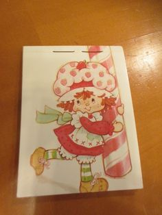 http://www.ebay.com/itm/Vintage-Strawberry-Shortcake-Small-Notebook-Pad-/252891005722?hash=item3ae17a831a:g:Rz0AAOSwOgdYra5ns