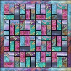 Batik Stained Glass Quilt Pattern...LudlowQuiltandSew The quilt measures 40″ square ...for this stained glass quilt I have used straight edges only and have added the black in as a 1/4″ sashing between the sections. The method that I have used makes this a really simple quilt to make – not a triangle in sight!..