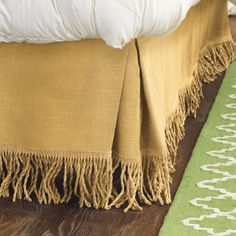 Fringed burlap bedskirt...might have to try this. Would LOVE it in white.