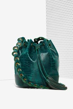 this Pun Croc Bucket Bag would look killer with a shredded band tee, dark skinnies, and leather slip-ons.
