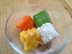 An organic homemade babyfood meal for your baby - pureed peas, and carrot with chopped mango and rice. www.carrotsandapples.com
