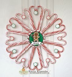 Candy Cane Wreath - http://creationsofanarmywife.blogspot.com/2013/12/peachy-keen-farewell-blog-hop.html?showComment=1387698127055#c3803373266292992406